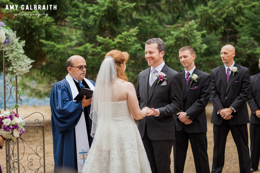 groom saying vows to bride at outdoor wedding
