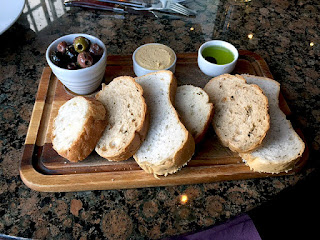 Fresh bread, hummus, olives and olive oil with Balsamic.
