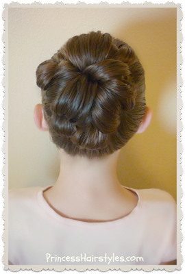 Quick and easy bun for ballet and dance. Topsy tail bun using no bobby pins.