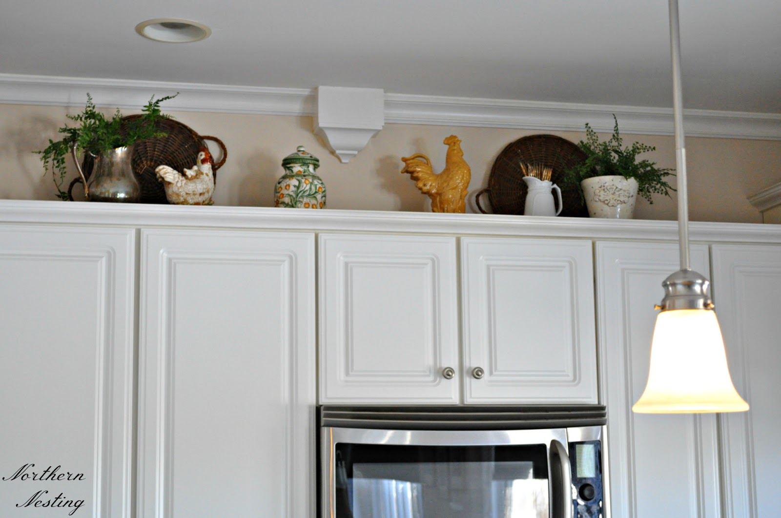 northern nesting a new look above the kitchen cabinets
