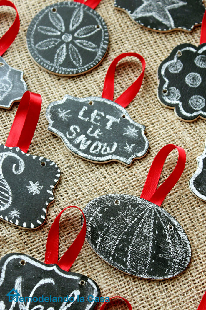 many chalk designs on little wooden tag chalkboards for Christmas