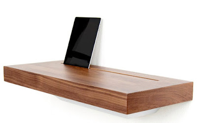 wood shelf with slot in the rear, where a tablet is resting