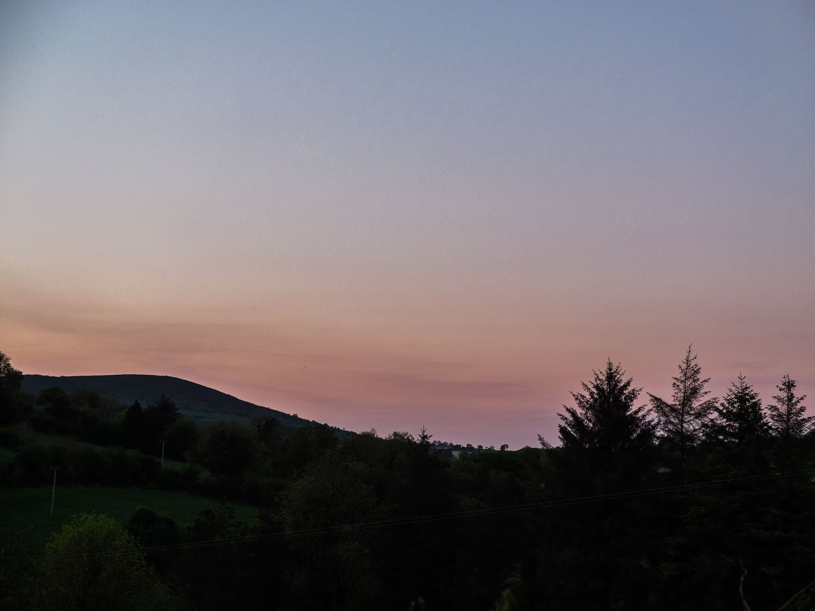 Gentle and pastel cloudless sunset over a mountain in North Co.Cork, Ireland.