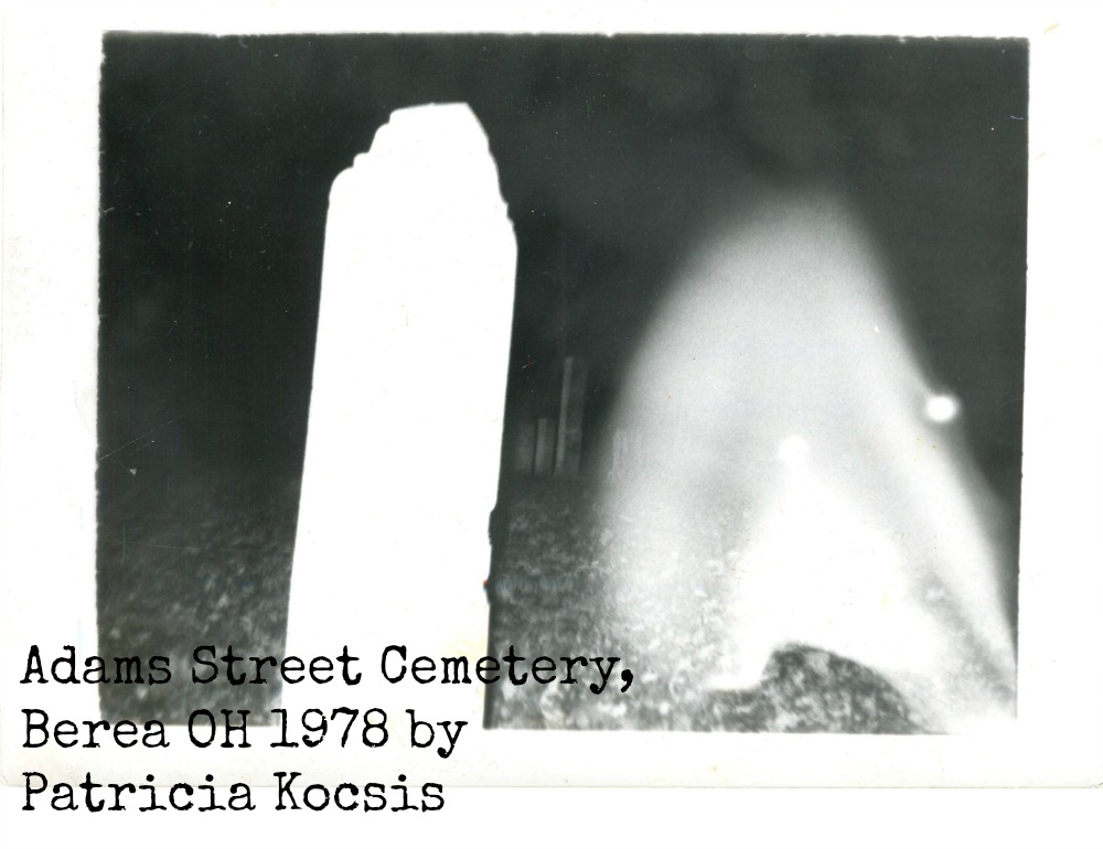 Ghostly image next to grave stone
