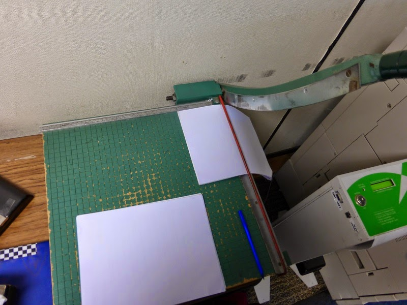 using the paper cutter
