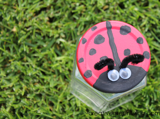 Paint the lid of a recycled glass jar to make an easy ladybug bug catcher craft that is perfect for your preschool or kindergarten class (or homeschool!). This craft is easy for kids to make and is a fun DIY idea that will get them out in the garden looking for bugs to trap in their jar. This is a creative project to make for Earth Day to teach about reusing materials you have on hand (like jars) an encourages STEM and science exploration.