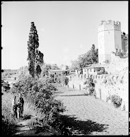 The Land Walls in the Yedi Kule, June 1935. Artamonoff recorded the outer and inner walls of the city that lay north of the Northwest Tower of Yedi Kule. Life outside the walls was quiet: wooden carts, simple houses, shops or cafes, a stone bridge, three boys and a dog walk on the cobbled Street that stretches along what was once a moat [Credit: © Nicholas V. Artamonoff Collection, Image Collections and Fieldwork Archives, Dumbarton Oaks]