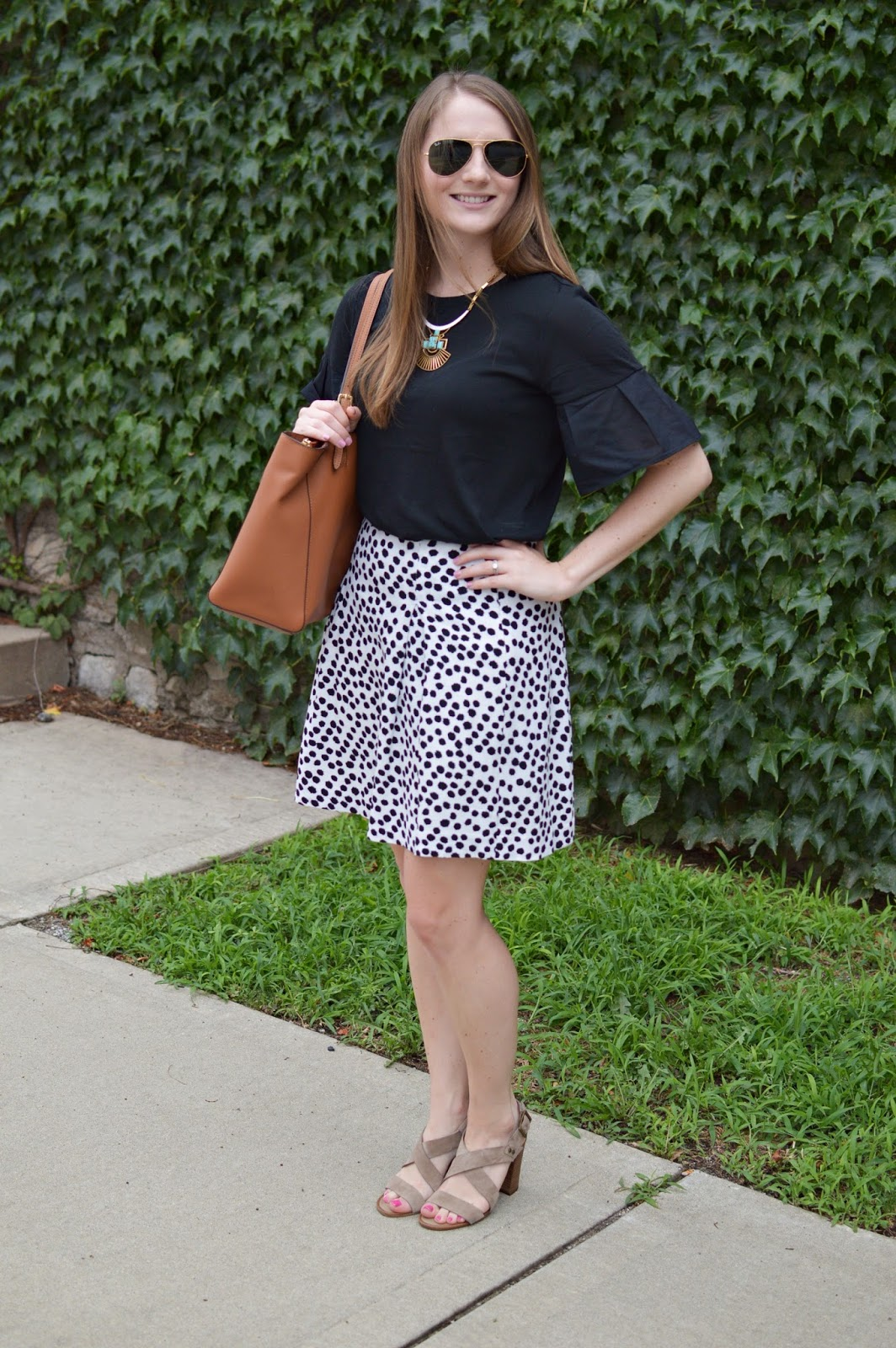 summer work outfit ideas | a memory of us | black flare sleeve top | black and white polka dot skirt | a memory of us | cute looks for work with skirts | how to style a polka dot skirt |