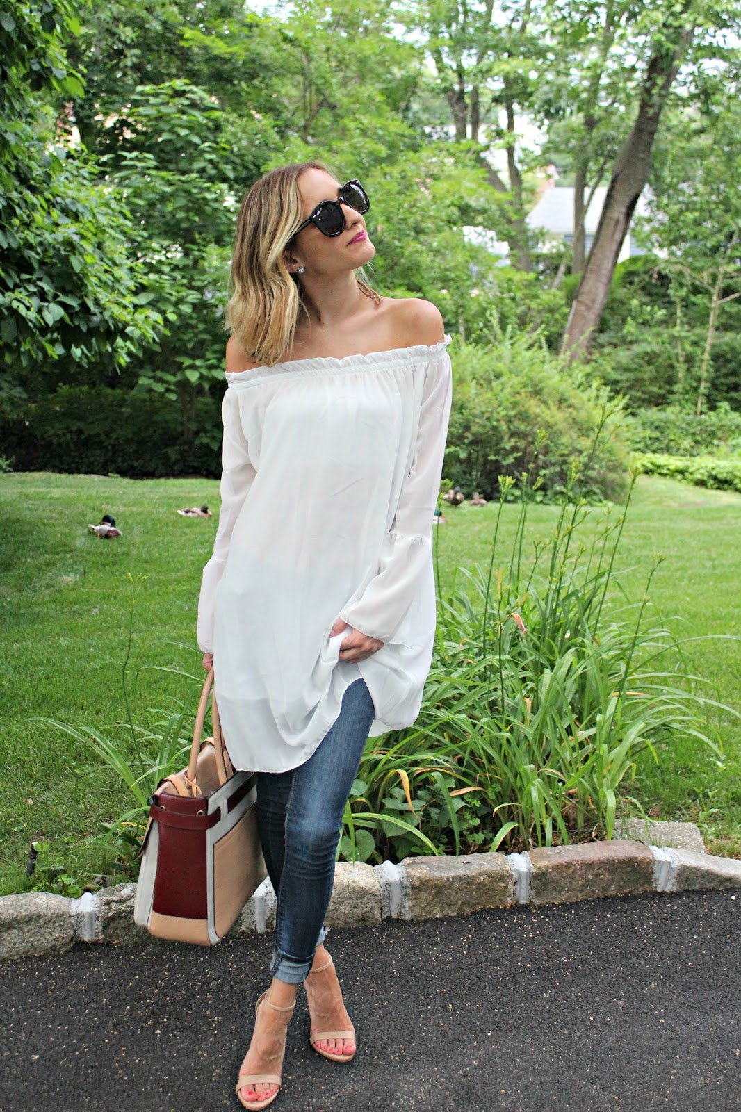 white off shoulder top with jeans