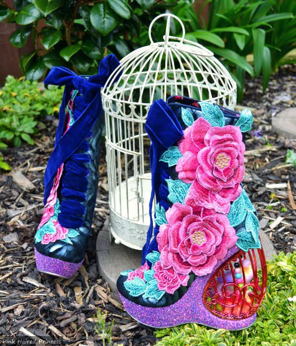 close up of floral Irregular Choice birdcage heels boots with birdcage outdoors