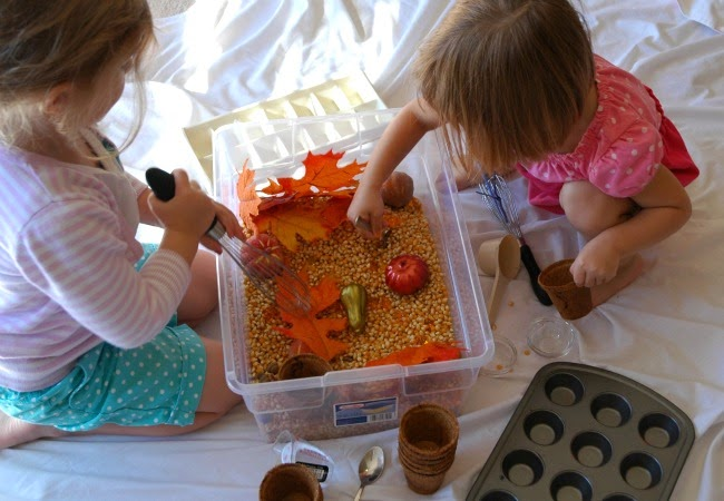 kids playing with sensory bin