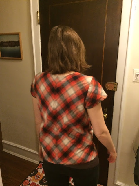Back view of plaid flannel Grainline Scout Tee, showing mirroring of plaid along center back seam