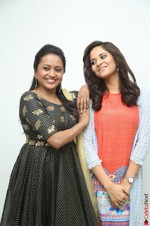 Actress Suma in Black Salwar Suit and Anusuya in orange Dress at winner movie press meet part 1 February 2017 (32).JPG