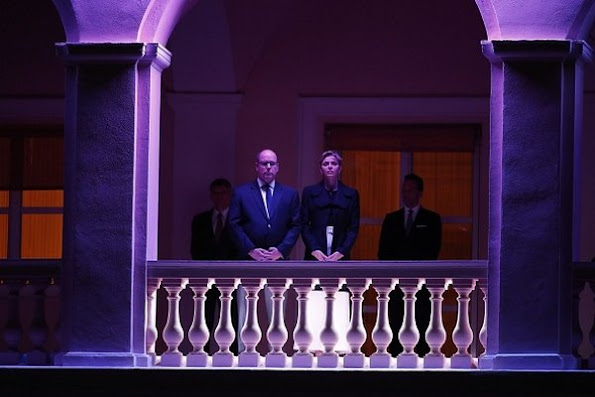 Prince Albert and Princess Charlene of Monaco appear on the balcony of the prince's palace to celebrate Good Friday, diamond tiara, diamond earrings, charlene wedding dress