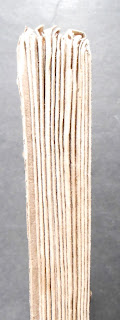 Image of unbound book from spine