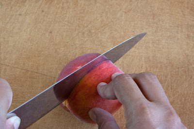 Cutting around the peach stone