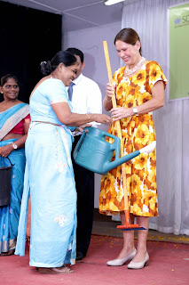 Nina Brandstrup, FAO Representative for Sri Lanka and Maldives presents gardening equipment to principals of 22 schools in the Sri Jayawardenapura Education zone at the school garden ceremony.