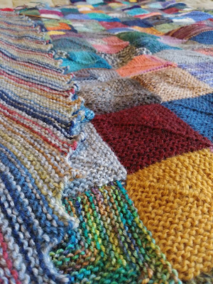 Knitting a mitered square blanket and a striped hitchhiker shawl