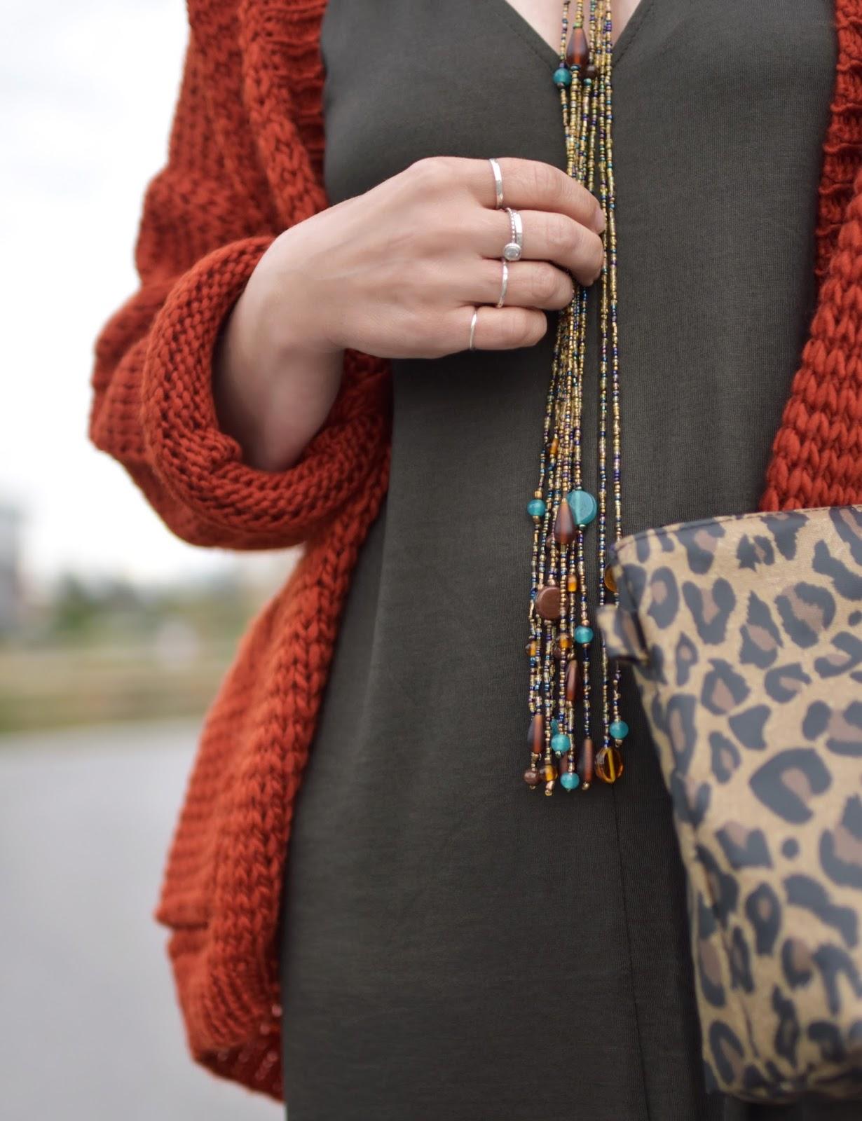 olive jersey caftan, chunky-knit cardigan, leopard-print clutch