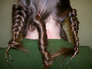 "Front and side views of ""braids"" made by wrapping the hair around a bent wire."