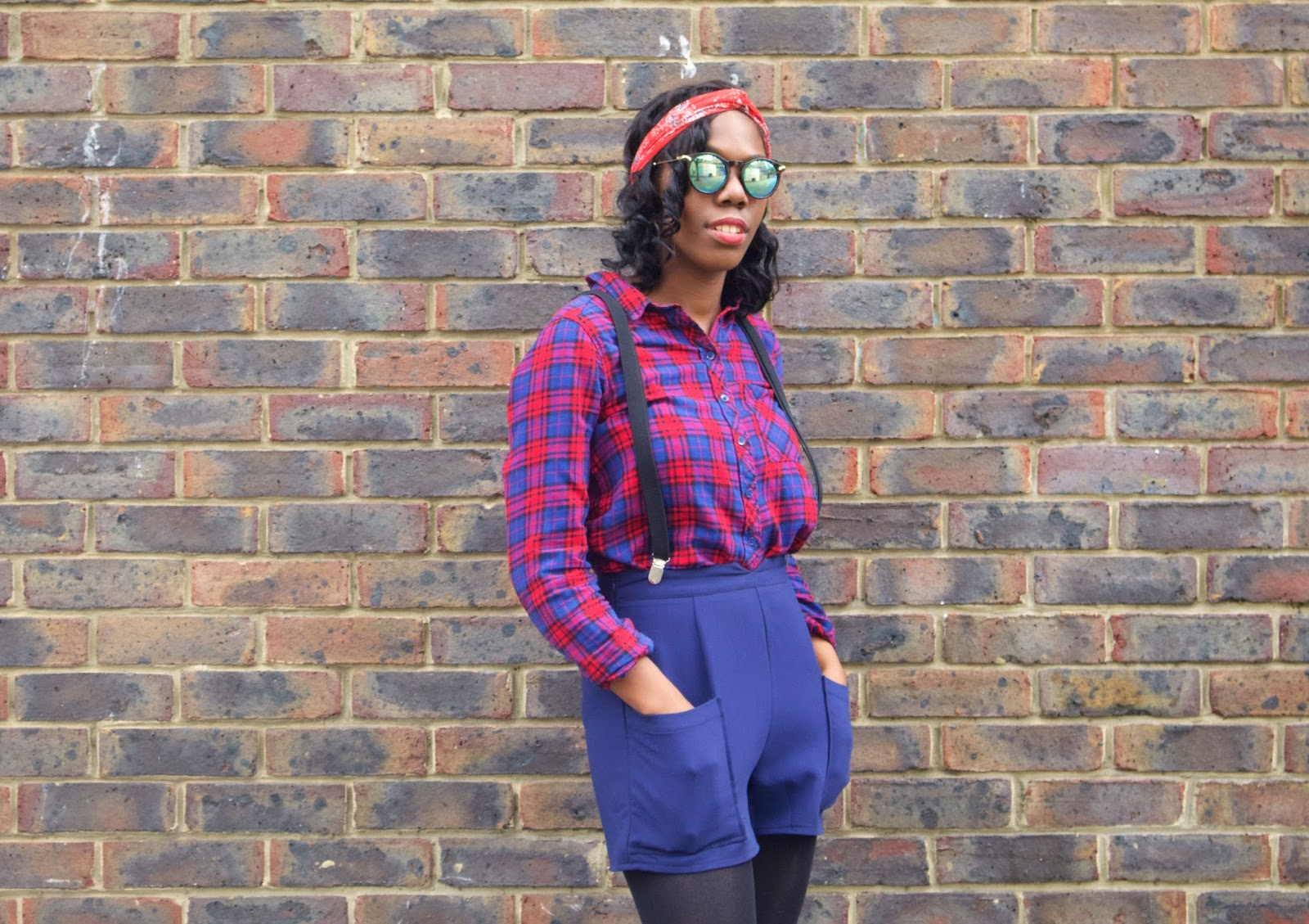 The Post Blogging Event Comedown, H&M checked shirt, H&M Red headband, ASOS green sunglasses, missguided navy high waisted shorts, black topshop braces, style blogger, fashion blogger, brick wall, uk blogger, black girls who blog, black girl magic