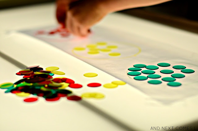 Color matching light table activity for kids inspired by traffic lights from And Next Comes L