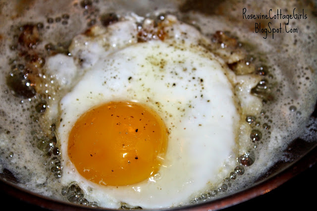 Pan holding a fried egg for the Hawaiian dish Loco Moco by RosevineCottageGirls.com