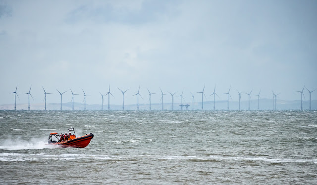 Photo of Maryport Inshore Rescue boat with Robin Rigg offshore wind farm in the distance
