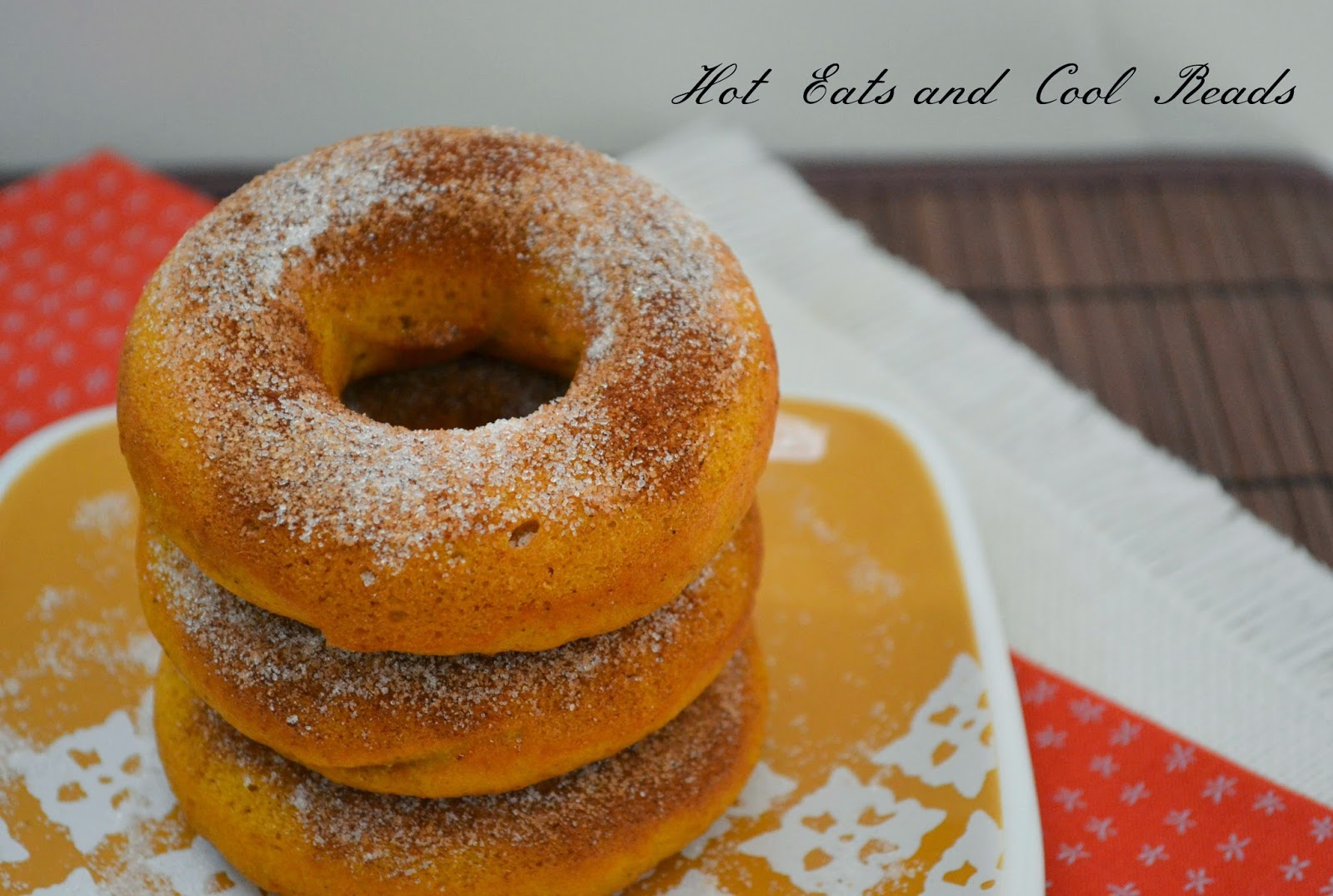 Baked Pumpkin Spice Donuts Recipe from Hot Eats and Cool Reads! These easy and delicious donuts or doughnuts are perfect for fall! Top them with cinnamon and sugar for a sweet breakfast, snack or dessert!