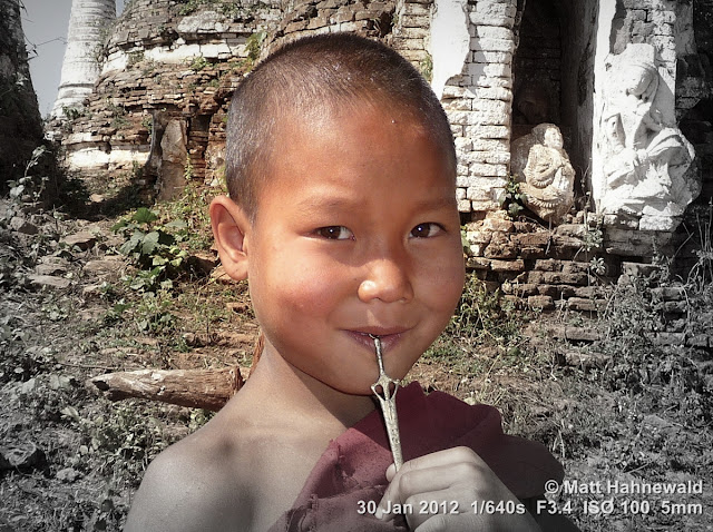 Burma, Myanmar, Inle Lake, young Burmese boy-monk, young Buddhist monk, people, street portrait, maroon robe, Burmese boy, focal black and white