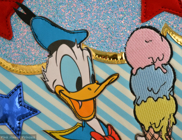 irregular choice whoa bag close up of donald duck face and ice cream applique on front of bag