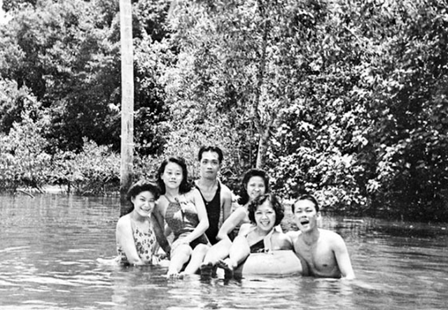 Mr. Lee enjoys the company of friends as seen on the picture swimming at Punggol River with close pals.
