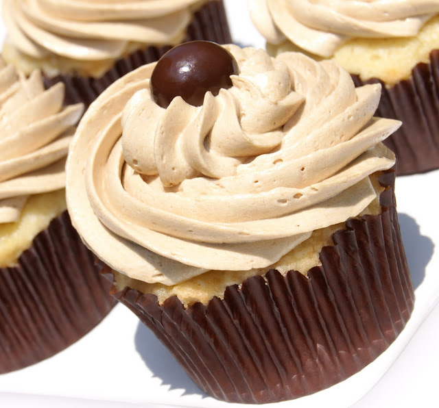 The BEST vanilla cupcakes with the BEST coffee buttercream frosting image.  A double sweet treat, for sure!   www.thekitchenismyplayground.com