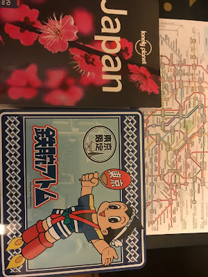 Guidebook cover, Tokyo subway map and an Astroboy lunchbox
