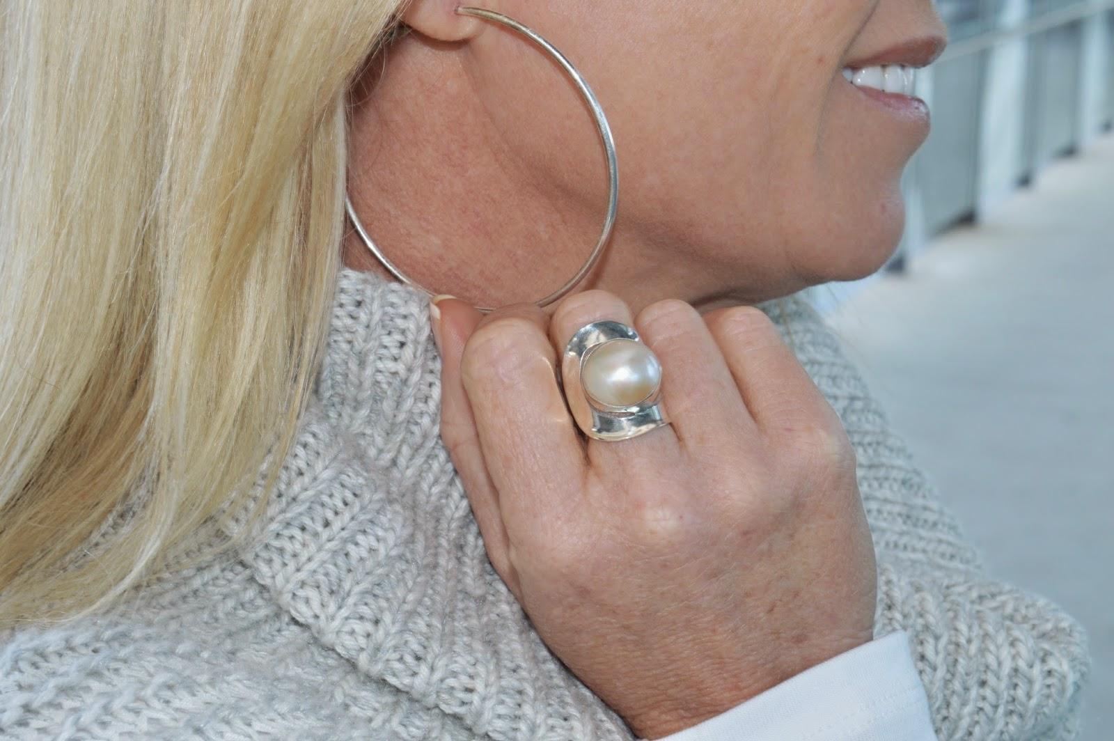 hoop earrings, grey sweater, pearl ring