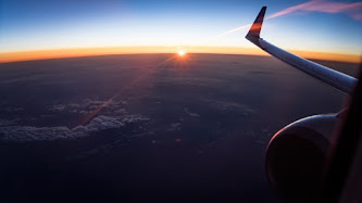 Flying with Airplane and Watching the Sunset