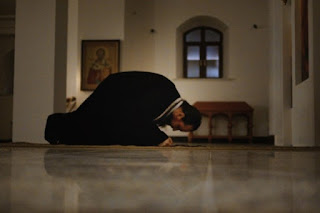 A Orthodox priest making a prostration