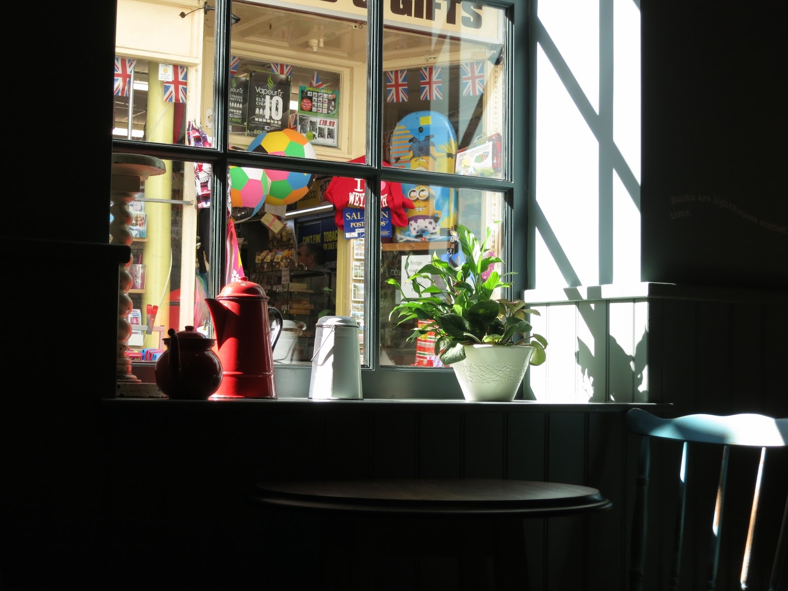 Looking out through cafe window into gift shop opposite.