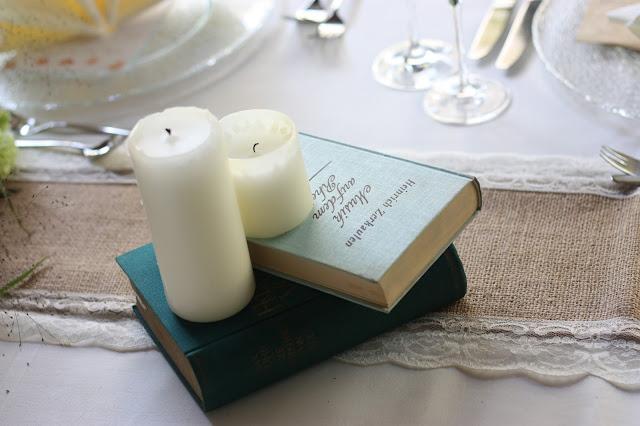 Old books and pillar candles Birdcage vintage wedding - Irish wedding in Bavaria, Riessersee Hotel Garmisch-Partenkirchen, wedding venue abroad