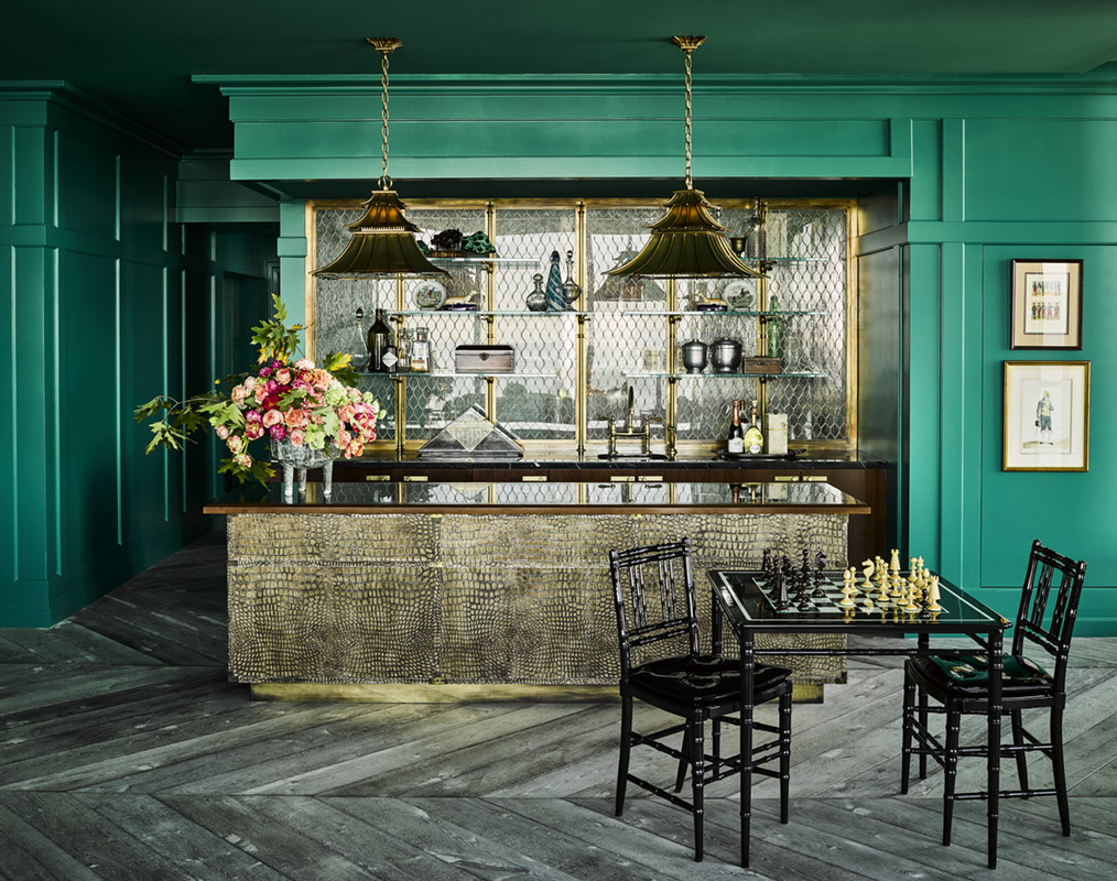 Dramatic bar with teal walls chess set chevron floor by Ken Fulk