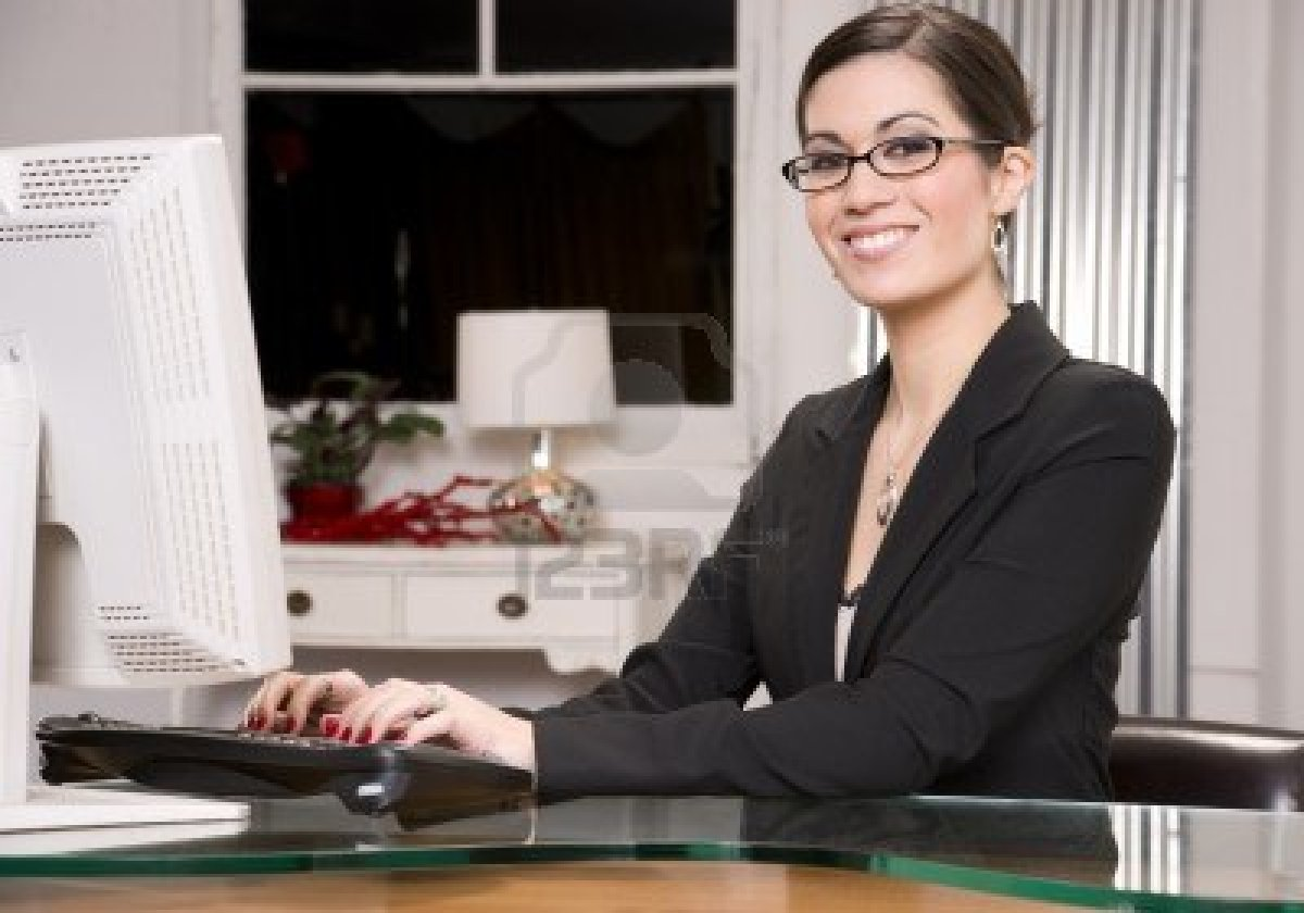 14593340-a-pretty-receptionist-smiles-at-the-viewer Online Form Filling Job Without Investment In India on