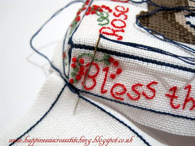 Cross stitched cottage with french knots a tutorial showing how to finish into a mattress pincushion