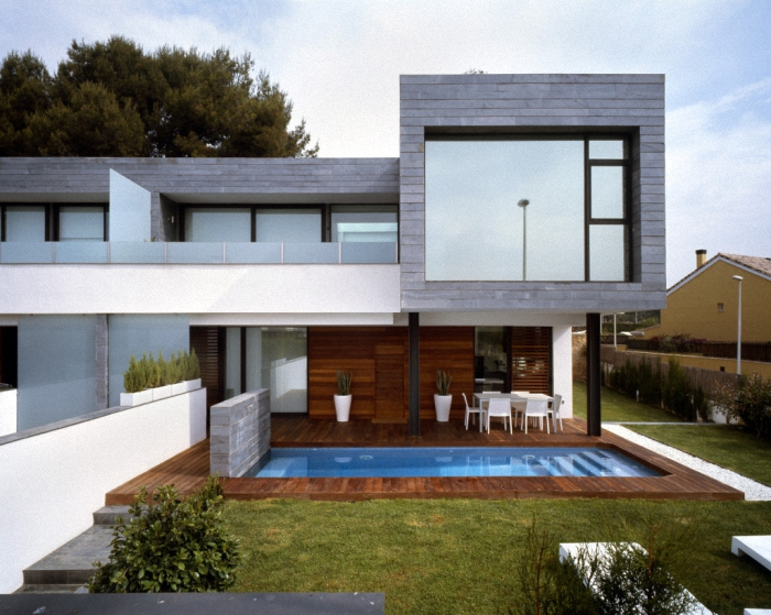 Hogares frescos 6 viviendas pareadas unidas por - Fachadas viviendas unifamiliares ...