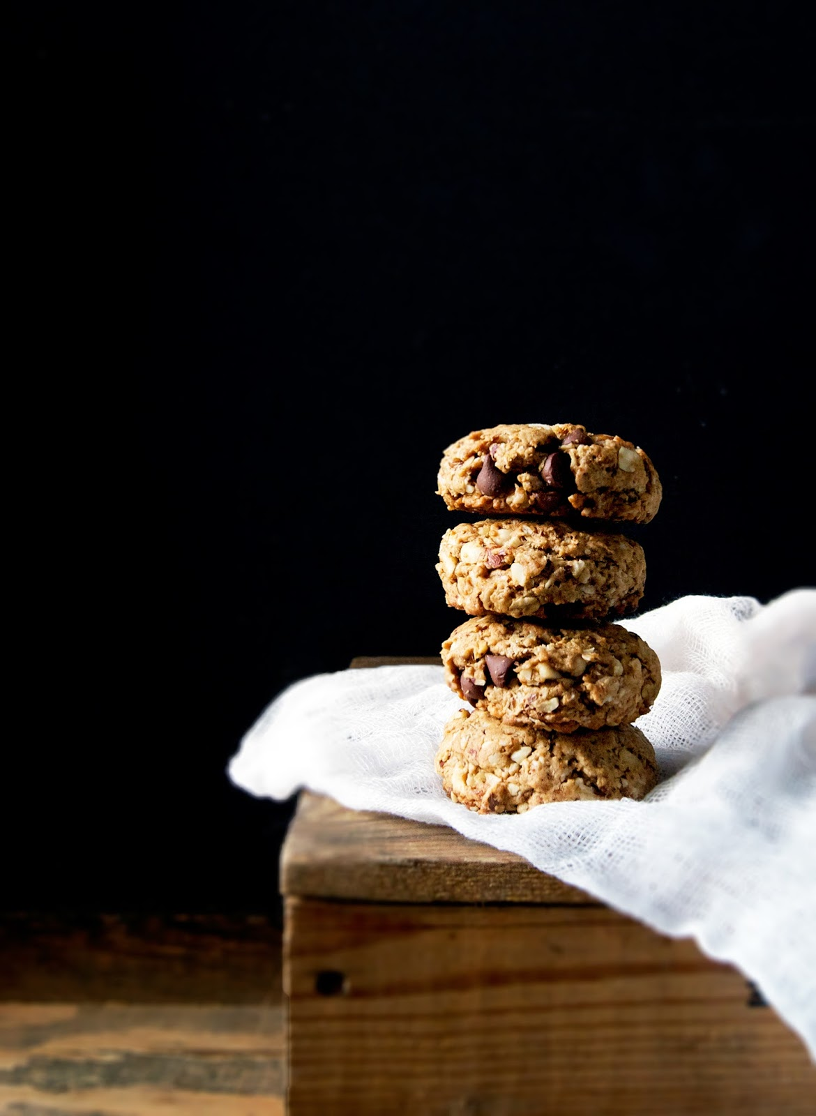 Vegan hazelnut oatmeal cookies, with chocolate chips and coconut sugar. Using hazelnuts as part of the base of these cookies adds richness and a buttery taste without adding any dairy.