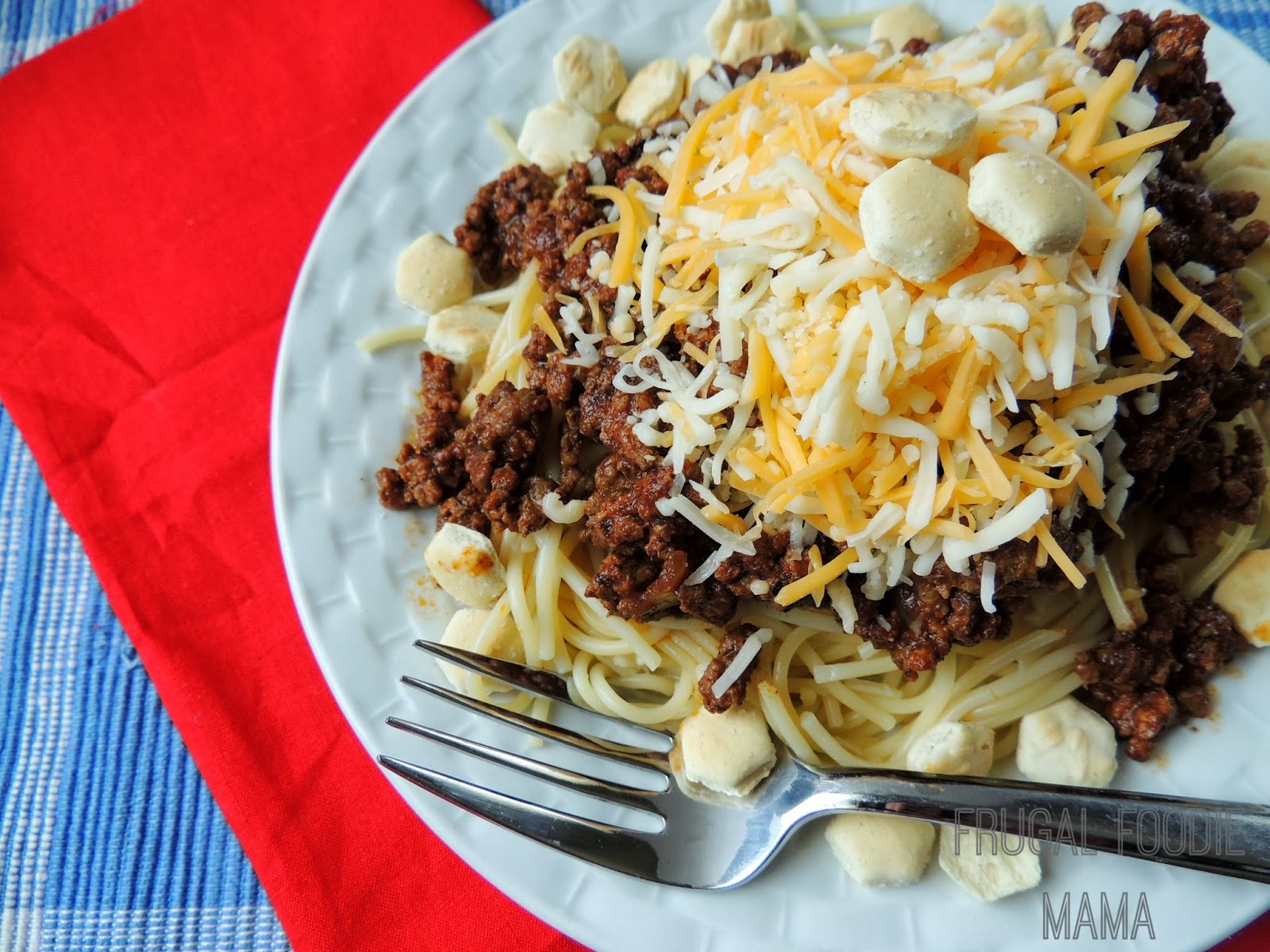 This CopyCat Cincy 3-Way Chili is a heaping plate of spaghetti topped with a perfectly spiced, slow cooked beef chili, a heaping mound of shredded cheddar cheese, & a sprinkle of oyster crackers... an Ohio favorite!