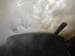 Smoke billows from under a lid - like a cauldron