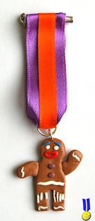 Foto medalla galleta de jengibre de fimo