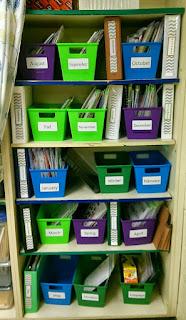 Different color plastic bins on shelves