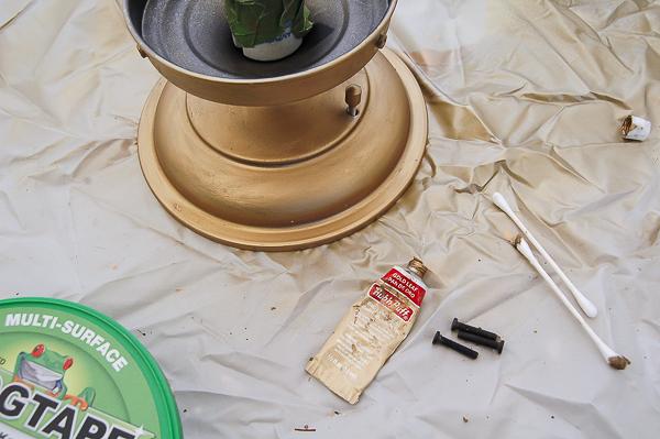 Applying gold leaf rub 'n buff to light fixture base