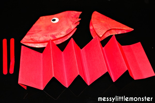 dragon puppet craft for kids.  Chinese new year activity.